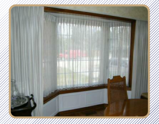 Window treatment with white curtains
